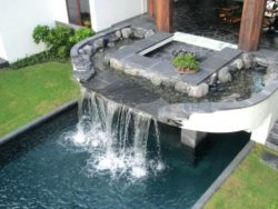 modern water feature on pool